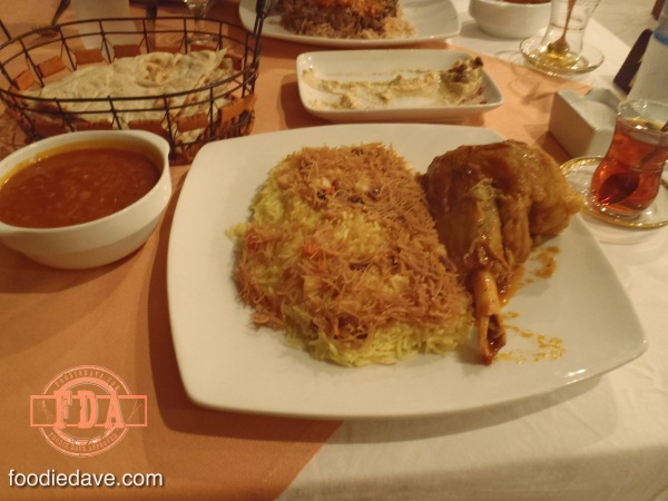 Roasted lamb leg with rice, served with curry sauce.